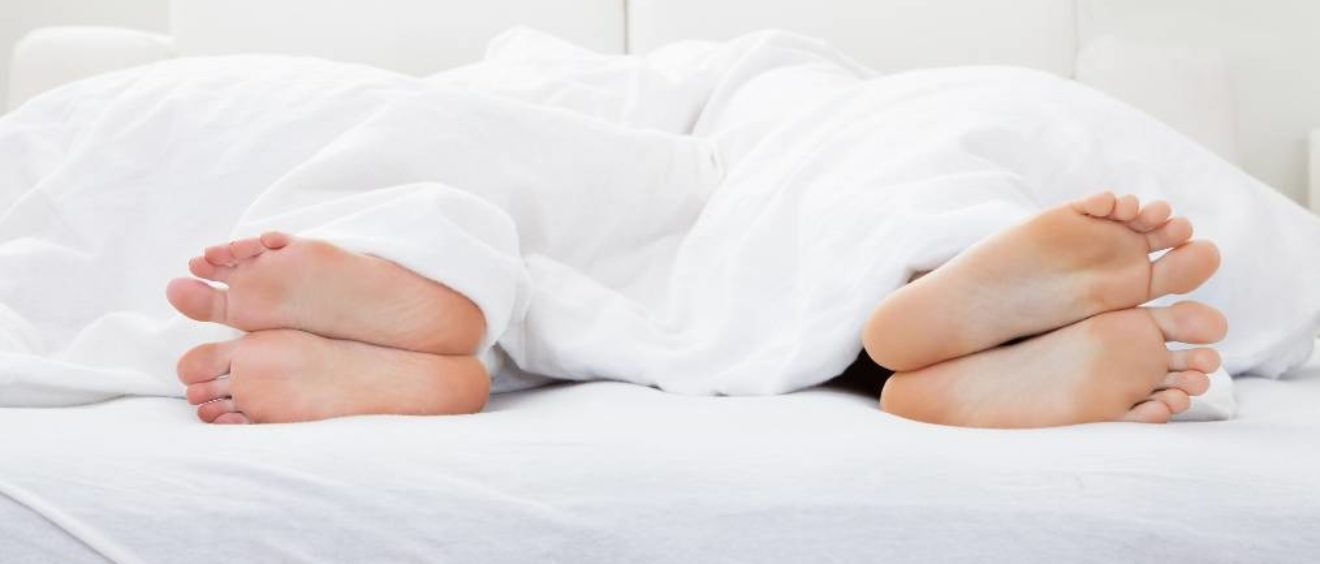 sexless relationship two people in bed facing away from each other