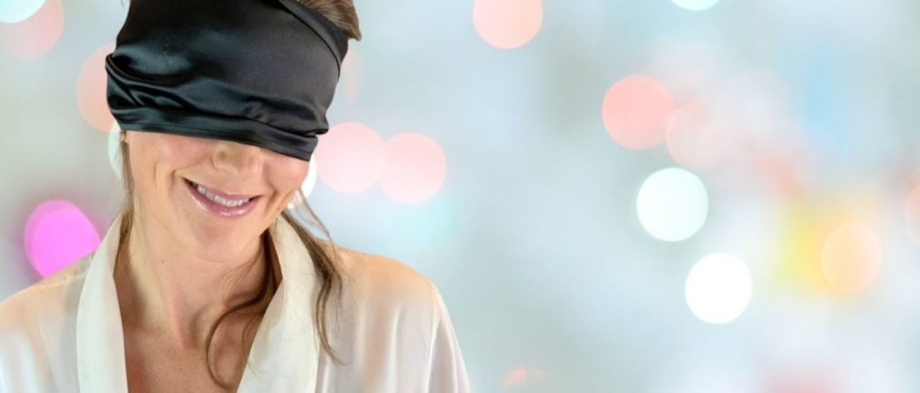 blindfold on Elisabet Barnes in white silk gown