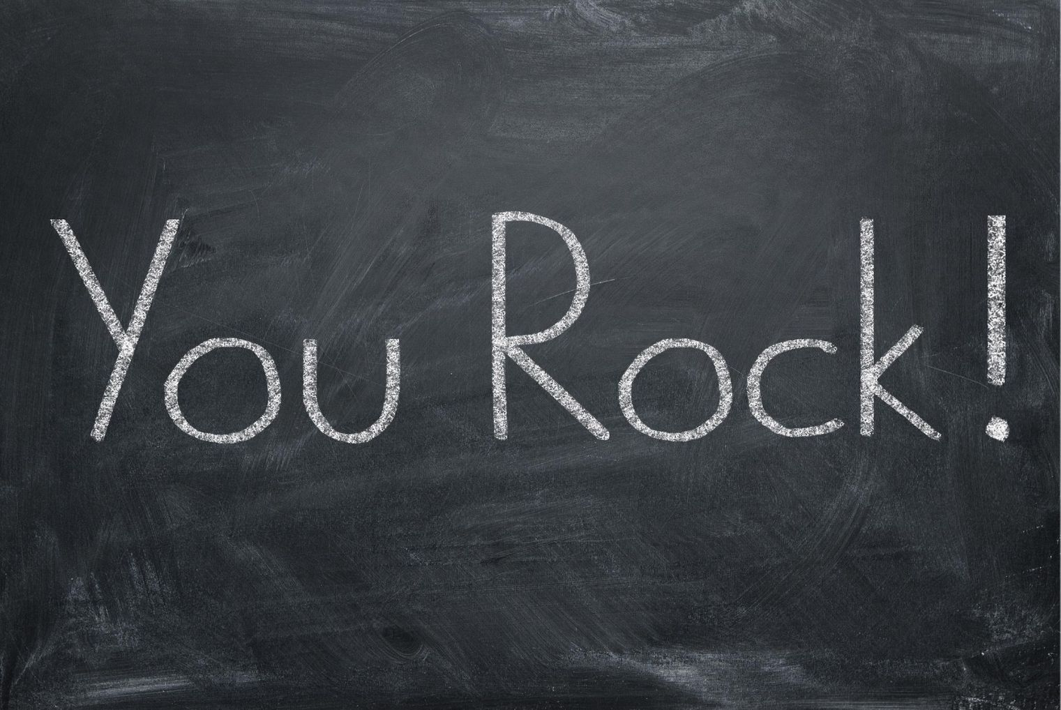 You rock written on blackboard. Love languages.