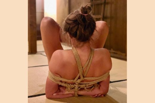 Kinbaku Shibari Elisabet Barnes on floor with hands bound