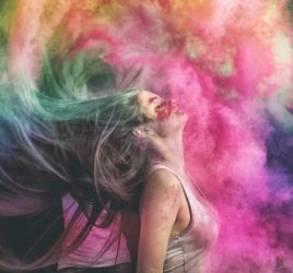 woman throwing her head back exploding in colours infidelity blog
