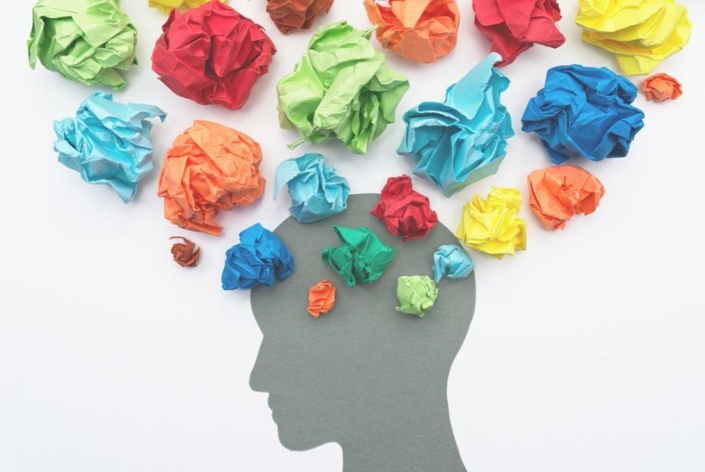 Head in profile with coloured paper balls, blog about couple arguments elisabet barnes