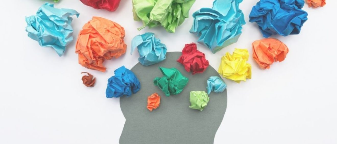 Head in profile with coloured paper balls, blog about couple arguments elisabet barnes