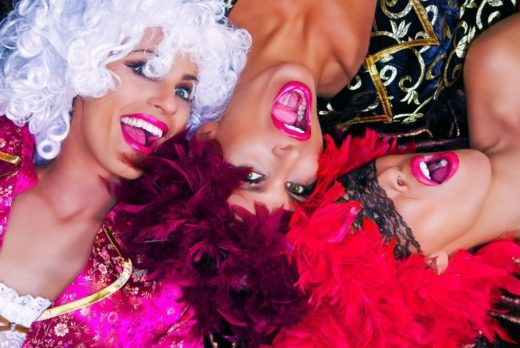 Three women smiling in colourful threesome
