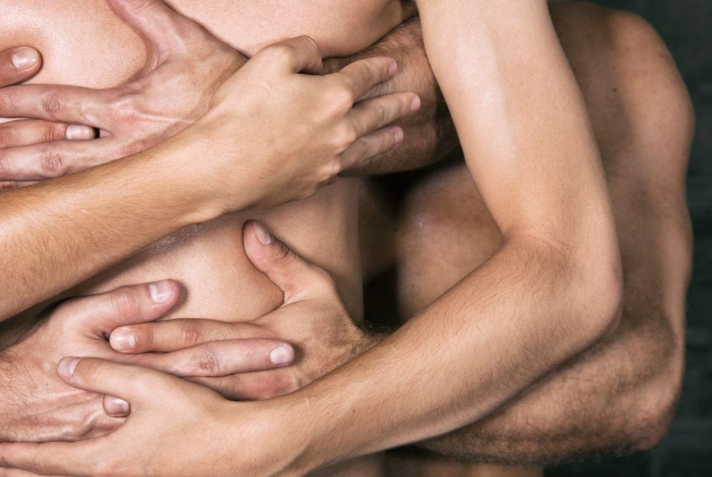 Three men embracing threesome